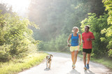 Fototapety Senior couple with dog running in green sunny nature