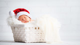 sleeper newborn baby in  Christmas Santa cap