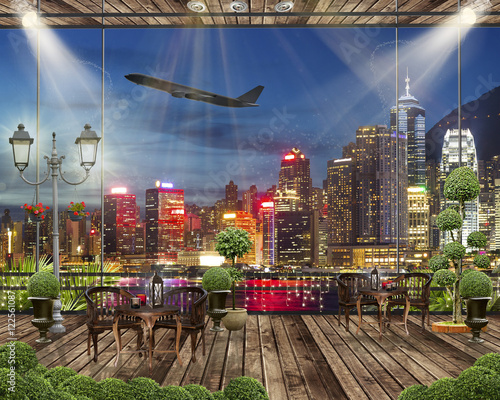 Fototapeta Wood terrace with romantic lights, Night city view