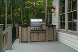 """Gas grill on deck with trees in background  122569891,Modern building"""""""