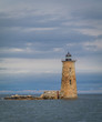 Whaleback Lighthouse in Kittery, Maine, on a cloudy foggy day in early Fall, portrait
