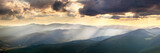 Panoramic View of the  Mountains  with Majestic Sunbeams and Clo
