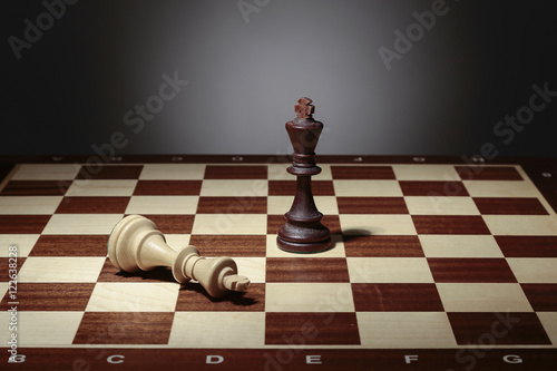 Poster One chess king standing and another lying on chessboard