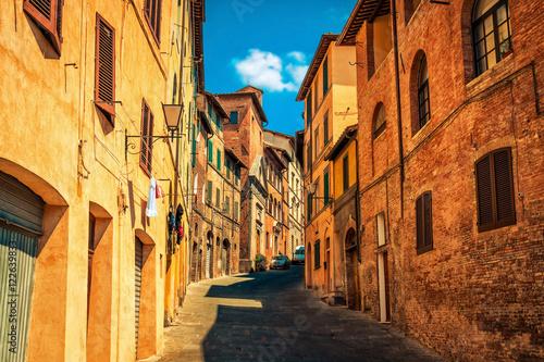 Narrow old streets in medieval Siena city, Tuscany region, Italy.