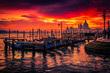 Sunset in Venice, Italy. View of gondolas and Santa Maria cathedral.
