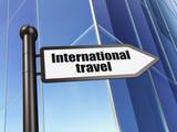 Tourism concept: sign International Travel on Building background