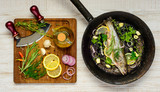 Fish in Frying Pan and Cooking Ingredients