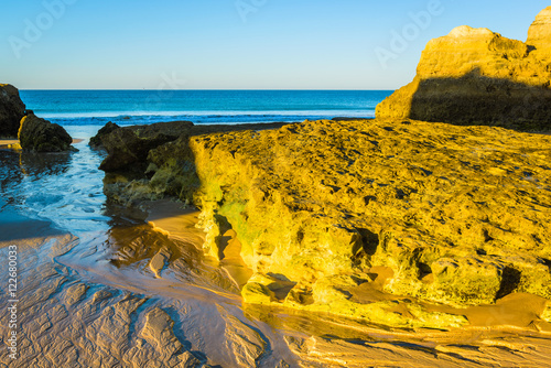 Fotobehang Morning on the beach of Praia da Rocha, Portimao Coast. Algarve region. Portugal