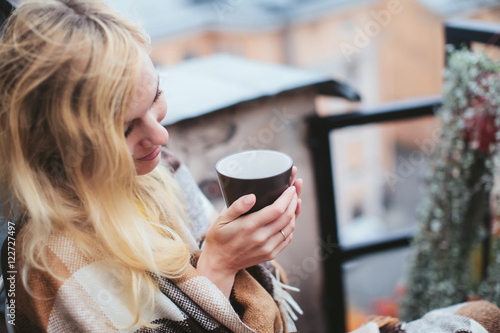 woman with tea sheltered blanket breakfast on the balcony overlooking the city © mnikolaev