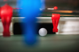 Red and blue foosball players in a row