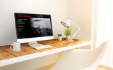minimalist workplace with video streaming computer