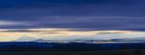 Beautiful autumn panorama of Tatra mountains and golden hills in