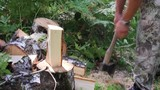 Lumberjack sawing wood chopping ax and chainsaw