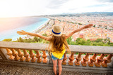 Young female traveler enjoying great view on the Nice city in France