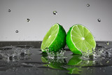 Lime with water drops on grey background - 122795664