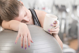 Woman Falling Asleep in the Gym