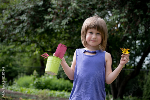 Poster 6 year old girl is enjoying gardening