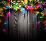 Wooden background with Christmas lights.