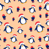 Seamless pattern with penguins on a peach background.
