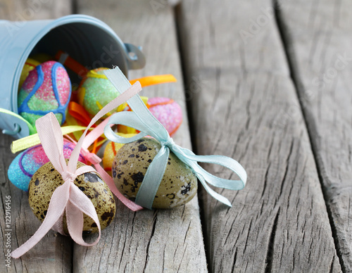 spring flowers and Easter eggs decoration on wooden background