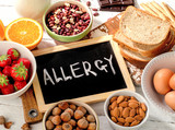Allergic food on wooden background.