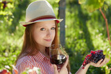 Happy Attractive Woman Enjoying a Glass of Wine at the Vineyard.