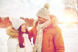 happy couple walking over winter background