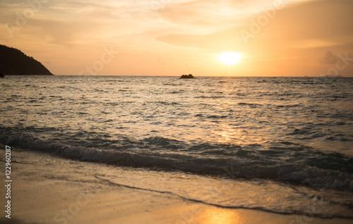 Foto op Canvas Zee zonsondergang sun set beach nature, white sand, seawater Sai Beach Koh LIPE