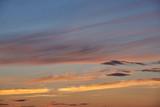 Cumulus and cirrus clouds sundown