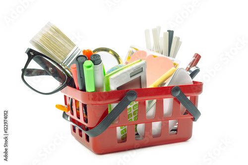 Poster Multiple office tools in a shopping cart, isolated on white background