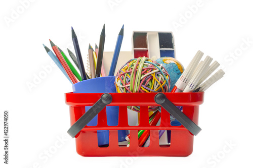 Stampa su Tela Multiple office tools in a shopping cart, isolated on white background