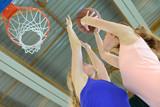Woman aiming towards basketball net