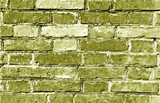 Weathered yellow brick wall surface.