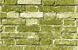 Weathered yellow brick wall surface.