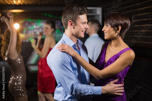 Cute couple dancing together on dance floor