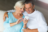 Senior couple using mobile phone 123053664,Oysters bed