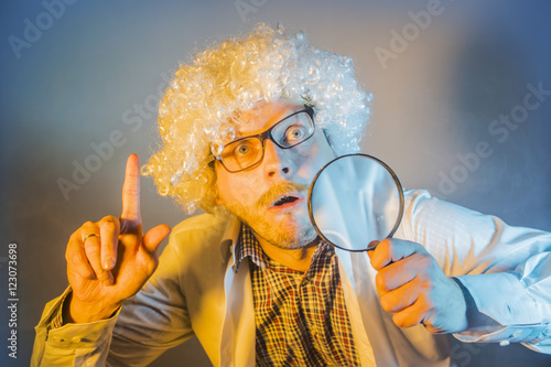 Poster funny scientist, like Einstein with a magnifying glass