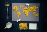 world map of muesli, milk. healthy breakfast. trade and globalization. top view