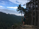 Man running on mountain forest trail