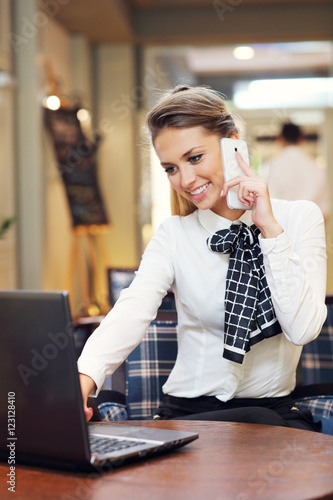 Young businesswoman working in restaurant