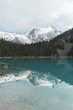 Joffre lakes provincial park Vancouver, British Columbia Canada. Glacial Mountains covered in snow with lake reflection. Pacific North West.