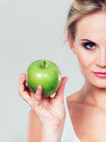 Fit woman holding apple fruit, dieting concept