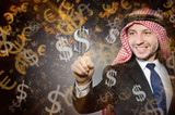 Arab man with dollars in business concept