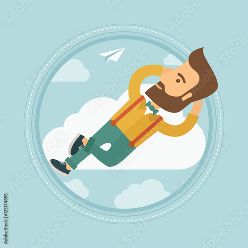 Businessman lying on cloud...