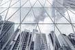 Reflection of urban skyline on modern office building - 123226215