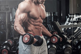 Muscular man doing a exercise for biceps