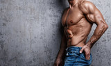Muscular torso of man wearing jeans