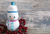 Plushie snowman with a cranberry stick