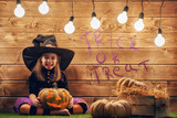 little witch with a pumpkin.