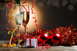Champagne fills the glasses and festive Christmas decorations
